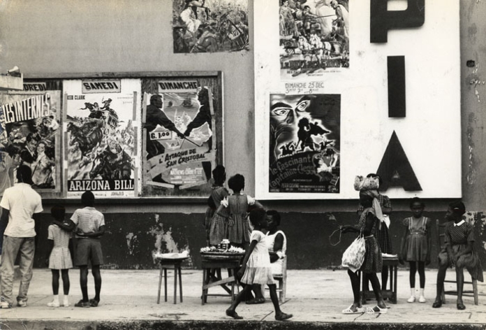 Port au Prince, Movie Poster on Theatre Front, Haiti. By Bernard P. Wolff. Silver gelatin print, c.1970. Stamped with artists name and title verso. At The Old Print Shop in NYC.