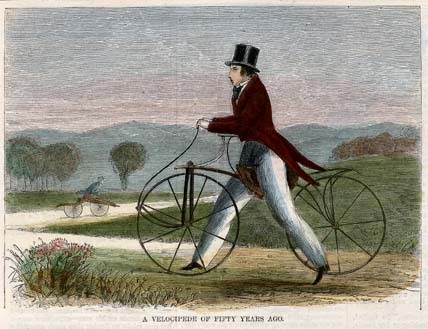 "A Velocipede of Fifty Years Ago. Published in Harper's Weekly. Wood engraving, with modern handcoloring, 1869. Image size 4 3/16 x 5 3/4"" (105 x 146 mm). AT OPS."