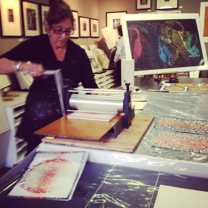 Susan Goldman, running the woodblock and Japanese paper through her small press