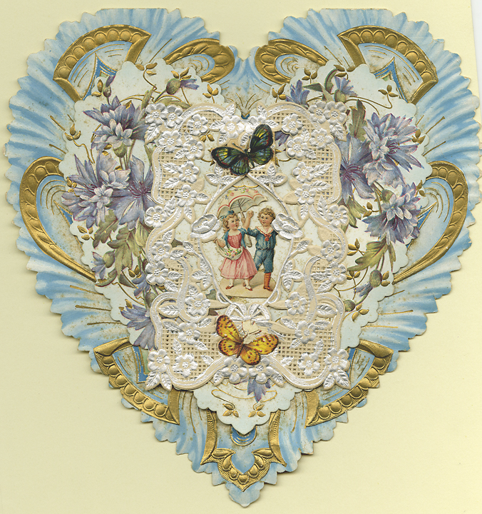 My Love to Thee : Unworthy are my hands to hold those dainty hands in mine, : Unworthy are my lips to touch those rosy lips of thine... Paper lace, c.1900. This cute heart shaped Valentine features a piece of silver and white floral paper lace with butterfly appliques on top. An applique of a boy offering an umbrella to a girl lays beneath. The next layer down contains an embossed floral card with golden highlights, which in turn sits on top of a blue and golden card. Image size 8 1/2 x 8 inches. LINK.